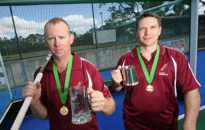 Queensland Masters hockey players Shane Johnson and Danny White are proud of their latest awards after a tournament win at Canberra.