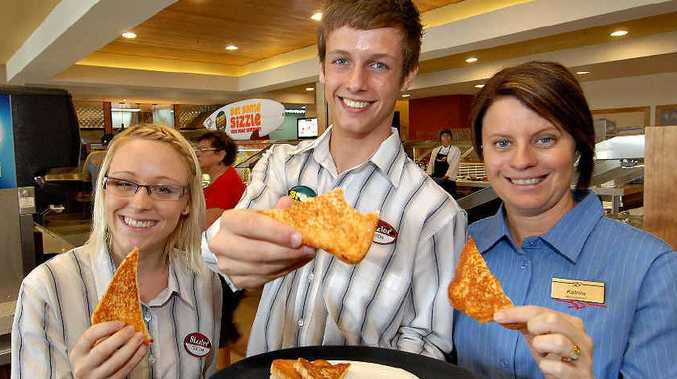 Sizzler staff Teagan Brookes, Jason Brookes and manager Katrina Nahow test some cheese toast yesterday.