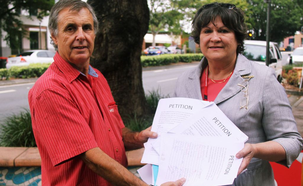 CBD Traders president David Fuller handed Member for Pumicestone Carryn Sullivan (Lab) a petition containing more than 1300 signatures for a Park and Ride facility to be built near Caboolture Railway...