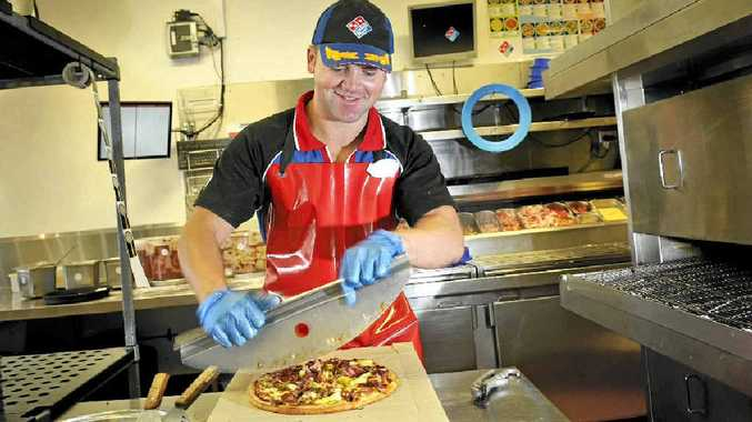 Domino's Pizza cook Lachlan Olm works overtime to conquer university-imposed poverty.