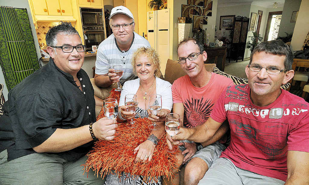 Toasting the civil union bill in Queensland are (from left) Artie Rocke, Ashley West, Maggie Gibson, Stephen Hall and James Crawford.