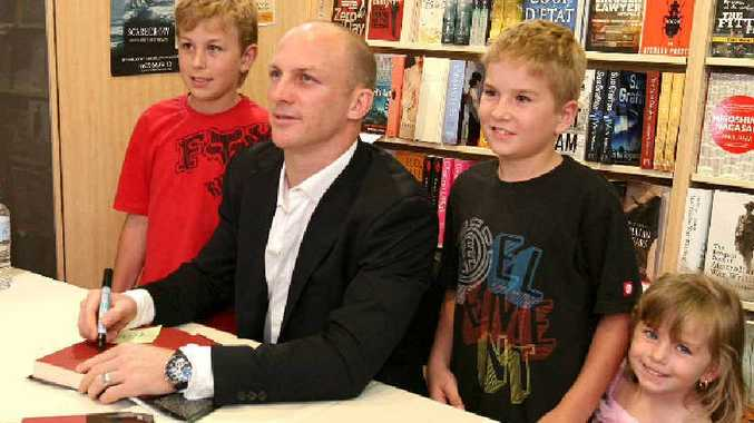FANS: Bailey, Keinan and Laylah Smith meet Darren Lockyer at his book signing at Collins Booksellers in Mackay.