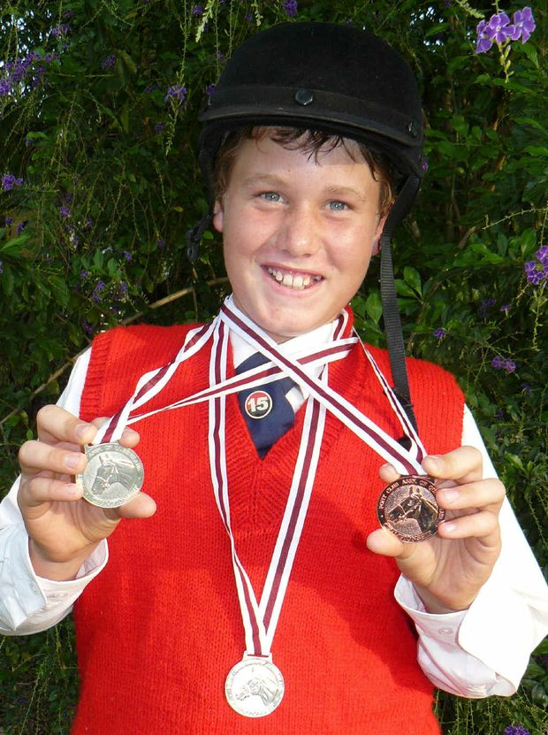 Emerald rider Wayne Hawke with his silver and bronze medals won in state competitions this year.