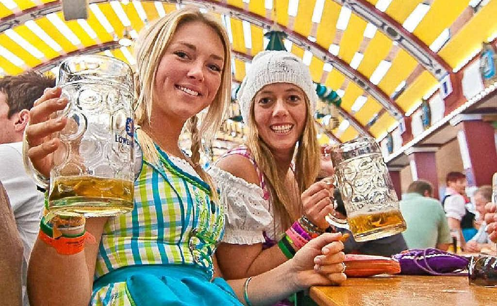 BOTTOMS UP: Beer drinkers flock to the Munich Oktoberfest.