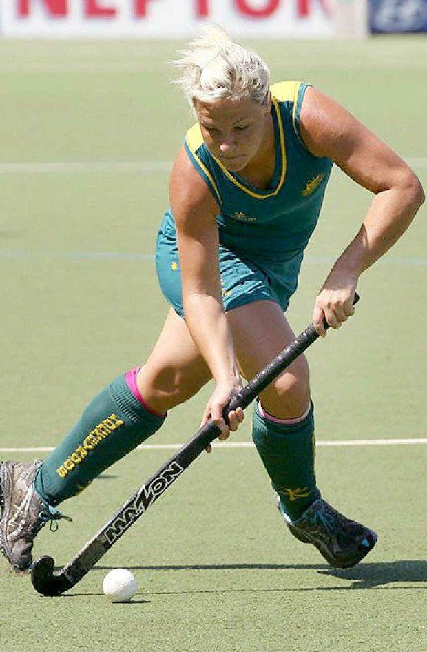 Ipswich hockey player Amy Korner runs hard during one of her 51 internationals.