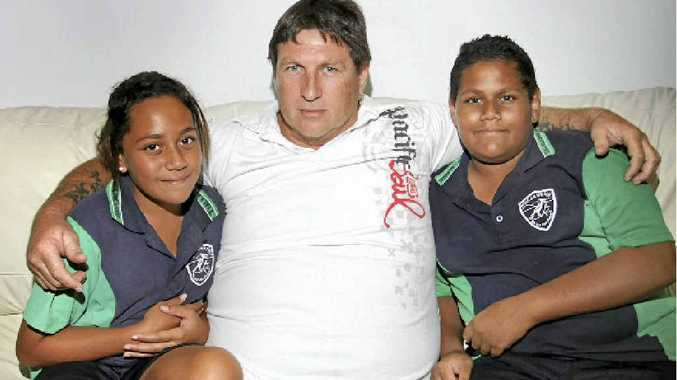 Mark White with his children Matthew, 12, and Emily, 11, is suing Queensland Health over the death of his wife, Alana.
