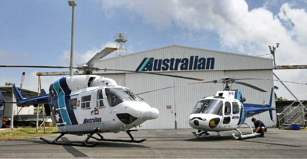 Australian Helicopters' new Kawasaki BK117B2 twin-engine helicopter, left, and the single-engine Eurocopter AS350BA Squirrel which the company has owned for a number of years.