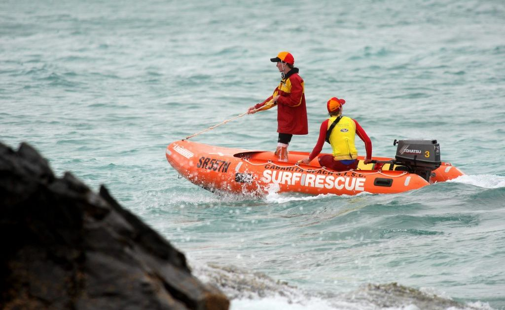 Rescue crew search for missing Kenyan teenager in Cabarita Beach.