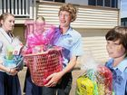 Students from Prince of Peace Lutheran College arrive with more than 80 'love bombs' to donate to flood-affected Ipswich residents. Photo: Rob Williams