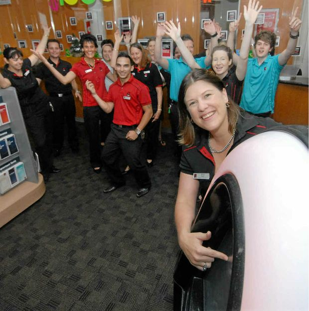 NAB customers and staff break into dance after store manager Nina Hall selects a song on the new jukebox.