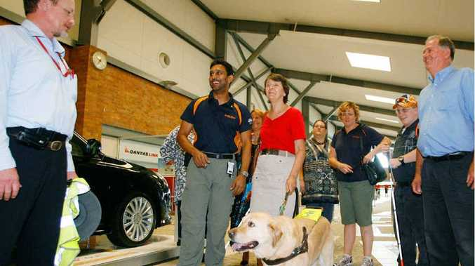 (From left) Bashir Ebrahim (Rehabilitation Services manager), Wendy Harris with Ranger, and Cr Graeme Brady tour the Rockhampton Airport with people who are vision impaired to familiarise themselves with the refurbished surroundings.
