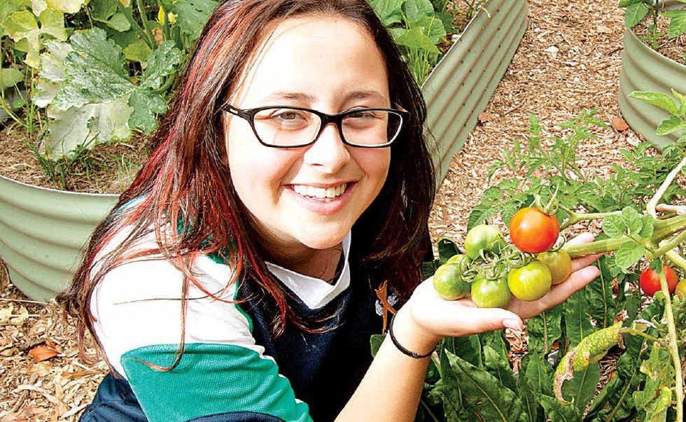 Chancellor State College student Rosie Anderson in the school's vegetable garden.