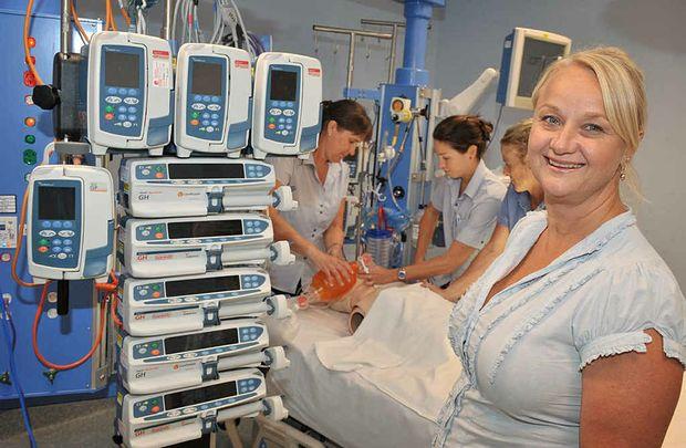 Intensive care unit nurse educator Jenny Jaspers collaborates with ICU clinical coaches Alex Ensor, Alison Bruce and registered nurse Jeraldene McKenna at Nambour General Hospital.