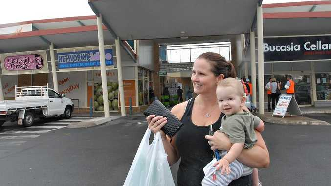 Linda Cohen at the revamped Bucasia Hibiscus Shopping Centre with arms full of shopping and son, Cohen.