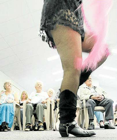 Kyogle seniors put on a burlesque bootscooting demonstration.