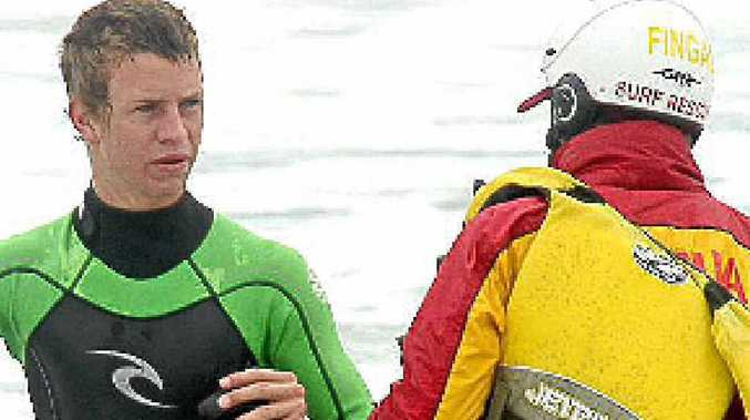 Surf lifesavers liaise during the search for missing teenager Samuel Macharia.