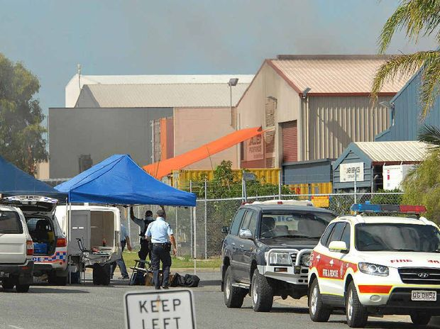 Smoke visible near the roof of Allied Pickfords in Mackay following siege.