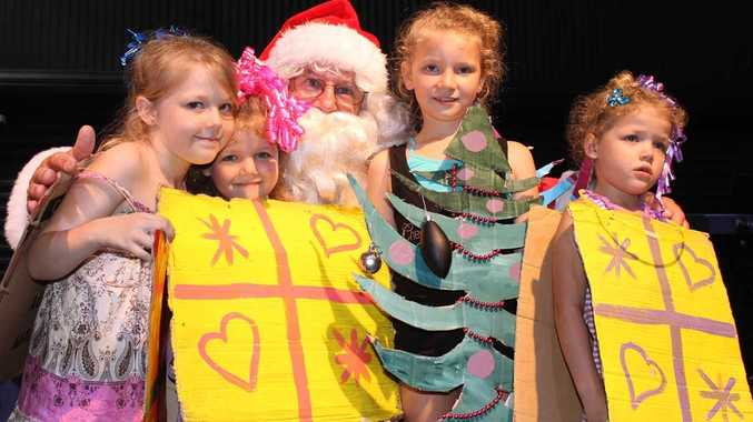 Funnel Bay kids Bonnie Car-Mitchell and Athina, Fayith and Elizabeth Mitchell dressed up and met with Santa at the Carols by the Beach night at the Whitsunday PCYC. Photo Zac Bailey / Whitsunday Times
