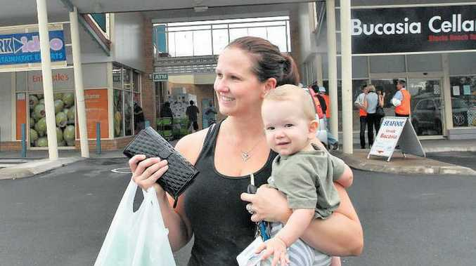 Easy Shop: Linda Rowe, with son Cohen, says the Bucasia Hibiscus Shopping Centre is a convenient place to shop for nearby residents.