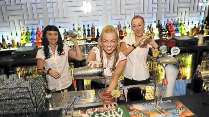 Bar attendants Kim Barnes, Di Smith and Rani Mazza prepare for One's opening night.