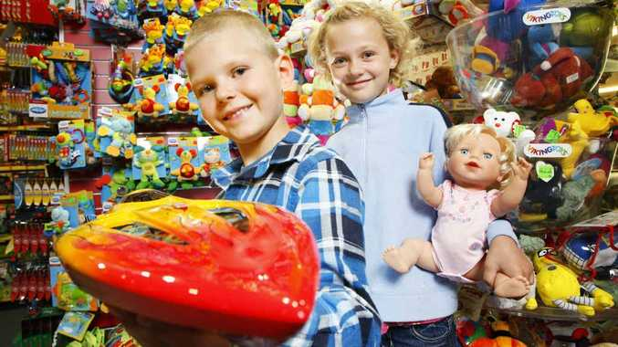 Jack and Chloe Wolters of Redbank prepare their Christmas wish lists at Mr Toys Toyworld at Redbank Plaza.