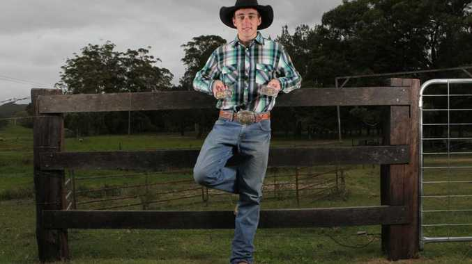 Wardell bull rider Josh Lock, the current National Rodeo Junior Champion shows some of his trophy belt buckles.