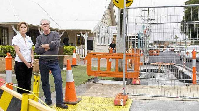 Disgruntled shop owners Joy Phillips, pharmacist and Tim Mulcahy, restaurateur in the Alstonville roadworks.
