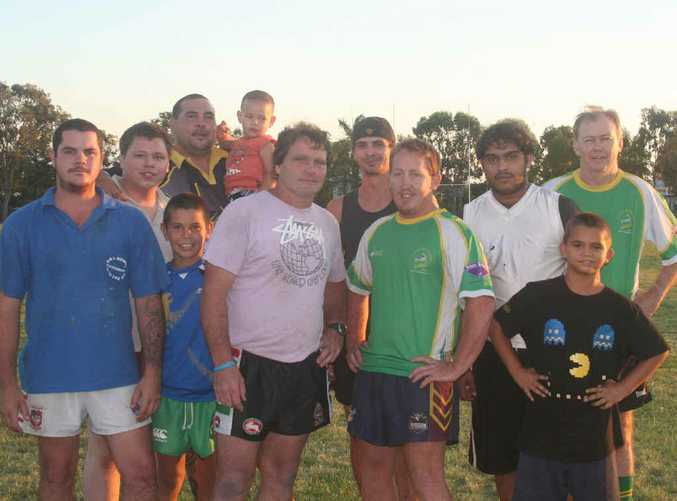 Les Horstman, front centre, with members of the Fitzroy Gracemere Sharks and family before last night's training session.