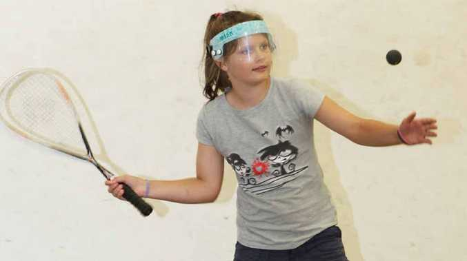 Courtney Mather lines up her shot at the junior squash finals at the weekend.