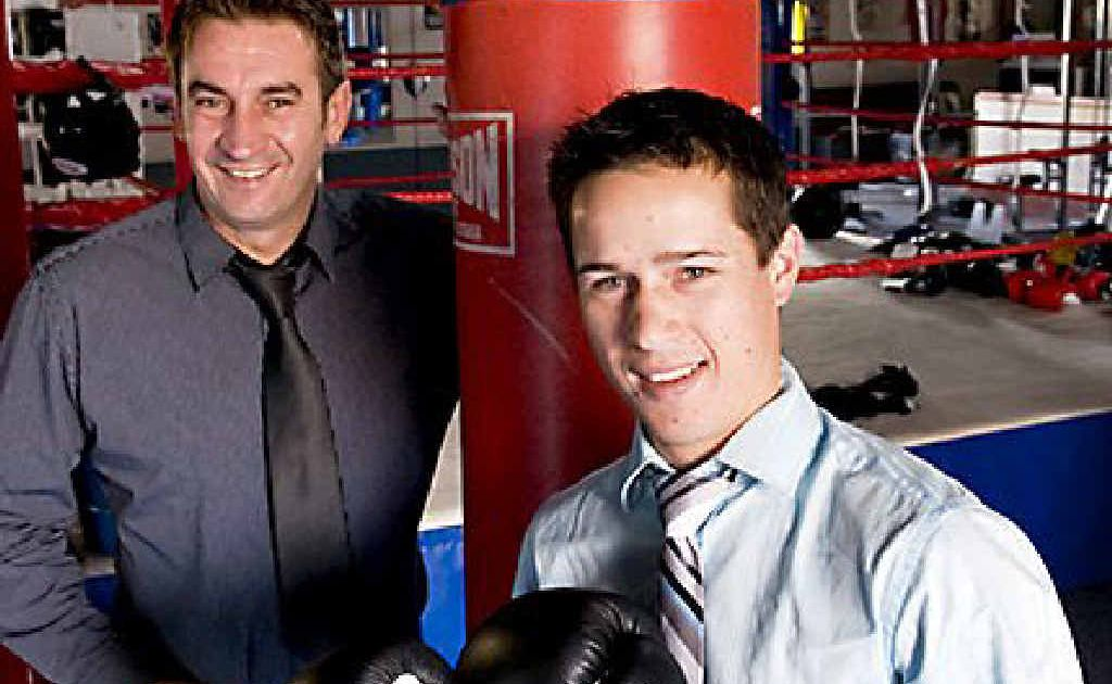 Boxer Will Young (right) signs on with Brendon Smith's promotion company.