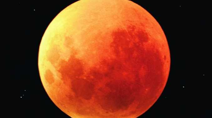 The moon will turn a dusty-red colour during a lunar eclipse just before midnight this Saturday night.