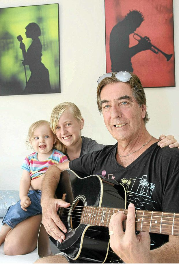 Musician Mikey St Clair and two of his daughters Bella Rose, 16 months, and Lara, 11.