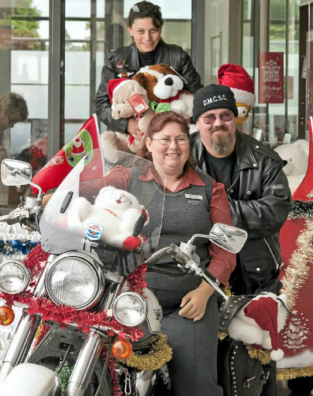 """All revved up for 25th annual Downs Motorcycle Sporting Club Toy Run are (from front) Bendigo Bank's Tracy Houlton, Michael """"Taz"""" Legard and Sue McKewin."""