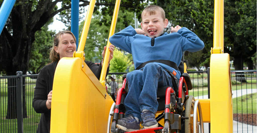 Cody Bergemann and mum Heidi can't keep the grins off their faces at the opening of the new Leslie Park playground and liberty swing.
