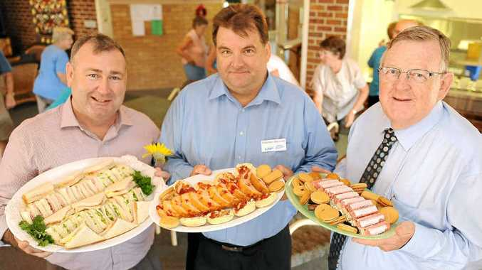 LNP party members Jack Dempsey, Stephen Bennett and Paul Neville put on a Christmas morning tea at Carlyle Gardens.