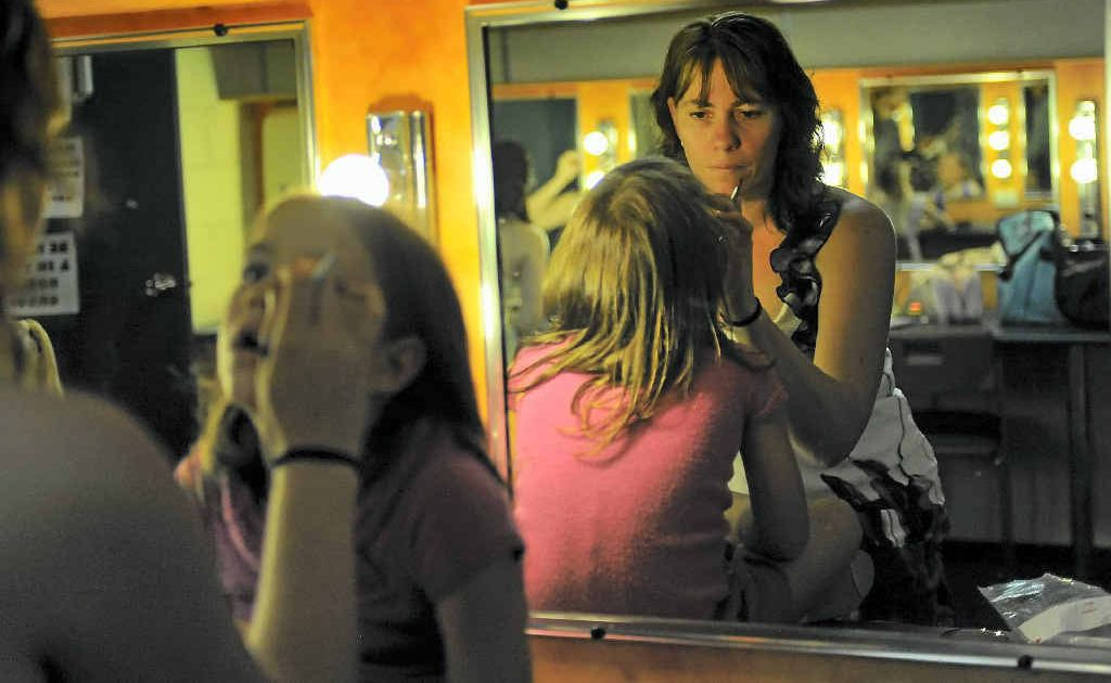 Amelia Ohl, 5, gets her make up done by mum Leanne.