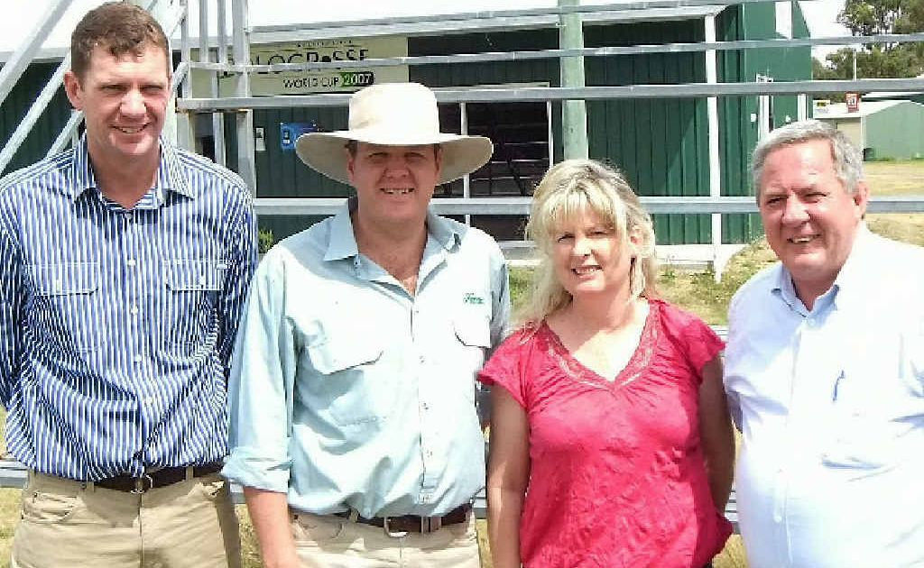 Warwick Polocrosse Club's Cameron Shepherd, Warwick Fraser and Andrea Sommerville receive $25,000 in funding from The Hon Tim Mulherin.