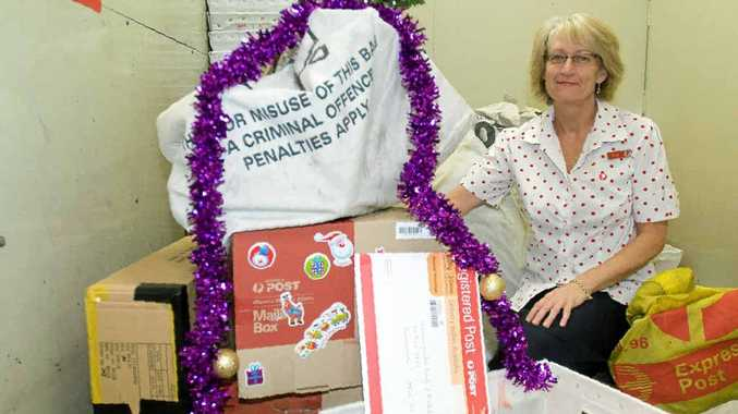 Lismore Post Office acting postal manager Esmae Law and her colleagues are striving to ensure all Christmas-related mail reaches its destination in time.