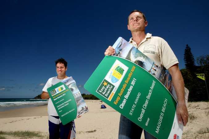 Peter McLean and Ashley Baldry celebrating Cabarita Beach winning the State Clean Beach award.