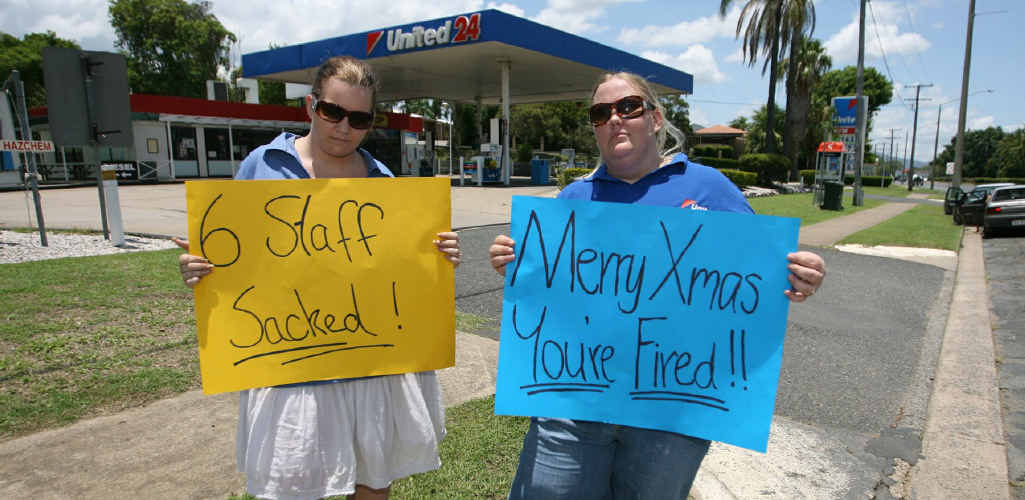 Kylie Meehan and Kylie Maunder protest the loss of their jobs outside the United Petrol Service Station on Lower Dawson Rd yesterday.
