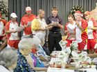 Members of the Sunshine Coast Scorchers cricket team sing carols for residents of Immanuel Gardens.
