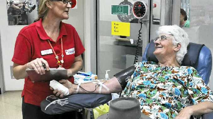 Clinical nurse Tracy Franssen takes blood from long-time donor Kathleen O'Donnell.