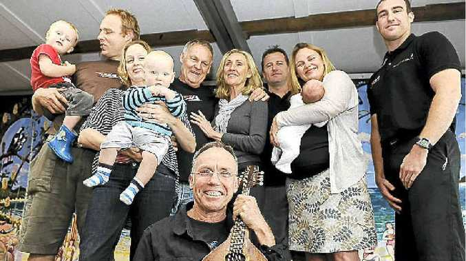 Helping celebrate 30 years at The Rails is regular performer Chris Aronsten (front) with the extended Mooney family, (from left) Luke and Benita with children Oscar and Sam, Tom and Cath, Hannah and Mike Spalding with baby Olive. At right is manager Whitney Woods.