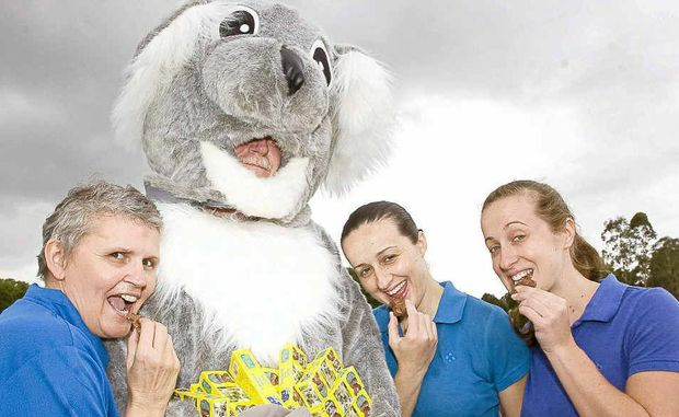 From left, Tracy King, Kevin King (dressed as a koala), Chantalle Fisk and Jocelyn Fisk enjoying the chocolate koalas.