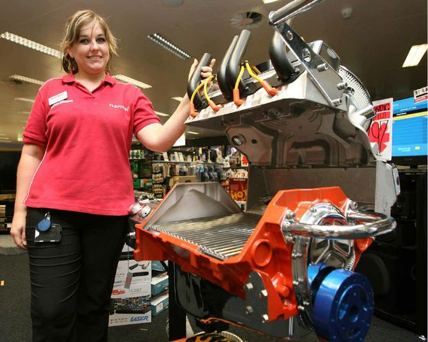 Harvey Norman appliance manager Angelique Dielwart with the Gasmate V8 Engine barbecue.