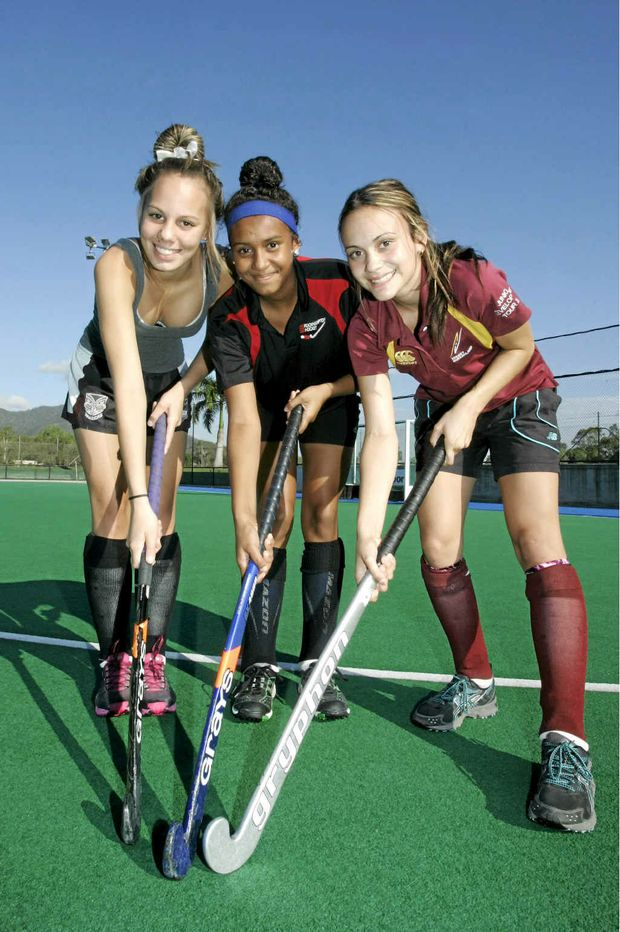 Rockhampton trio Shyneal Saunders, 15, Lucretia Willie, 13, and Jasmine Cleland, 16, are all smiles after being selected in first official Hockey Queensland Indigenous team.