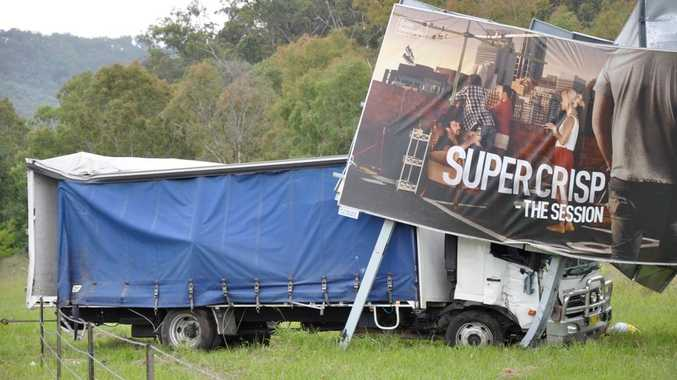 Power was cut to 420 customers after this truck clipped a power pole before crashing into a billboard.