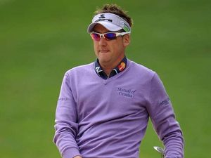 Giles threatens Poulter's lead