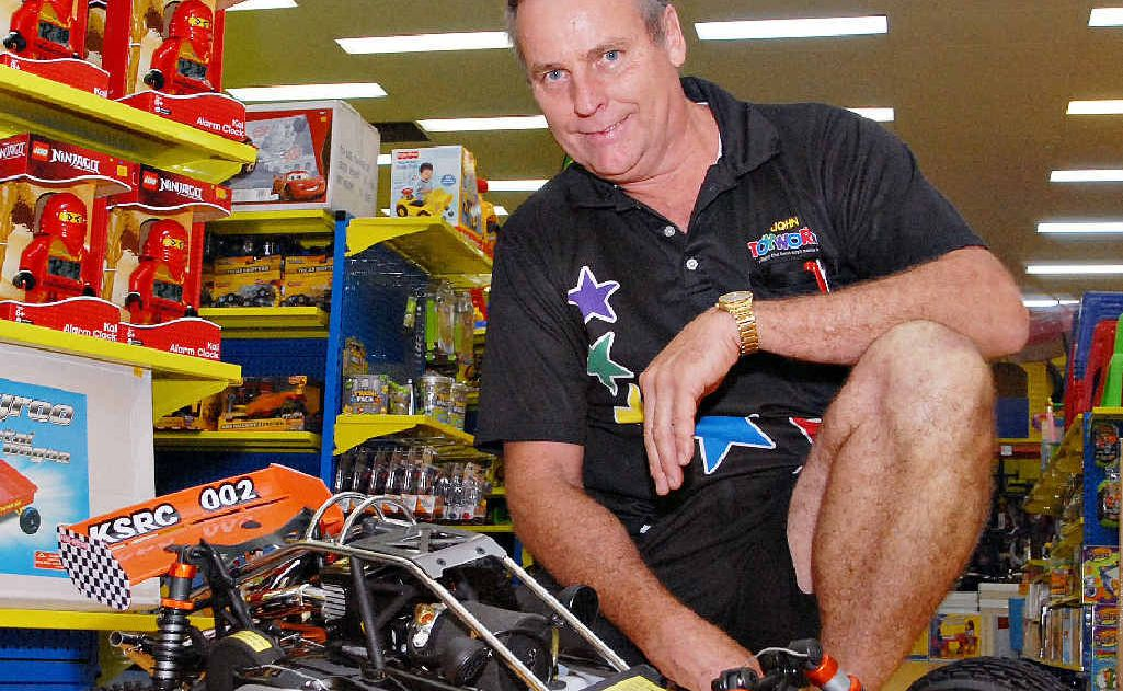 John Meneo, owner of Toyworld at Northpoint Retail, Mackay, with a one-fifth scale, off-road Baja buggy, one of the best-selling toys this year.
