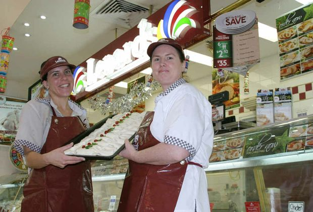 Angela Kerrigan and Jodie Stirrat show off the Lenard's Christmas Bon Bons which are proving a hit with locals.